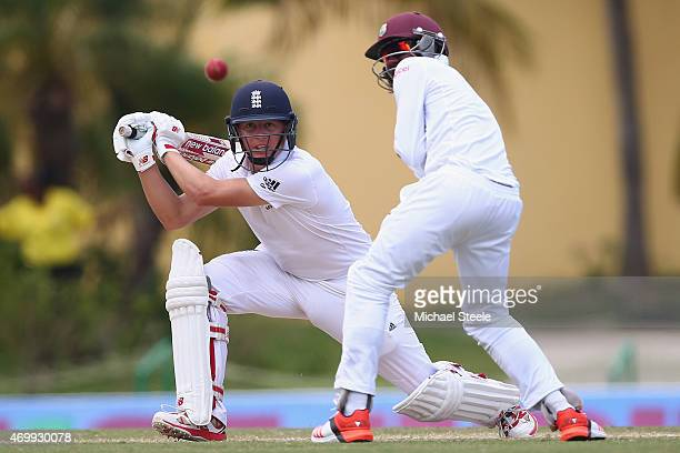Gary Ballance of England plays through the covers as Jermaine Blackwood fields in close during day four of the 1st Test match between West Indies and...