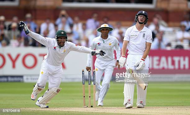 Gary Ballance of England reacts after being bowled by Yasir Shah of Pakistan as Sarfraz Ahmed celebrates during day four of the 1st Investec Test...
