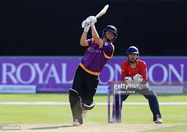 Gary Ballance of Yorkshire hits out as James Foster of Essex looks on during the Royal London OneDay Cup Quarter Final match between Essex and...