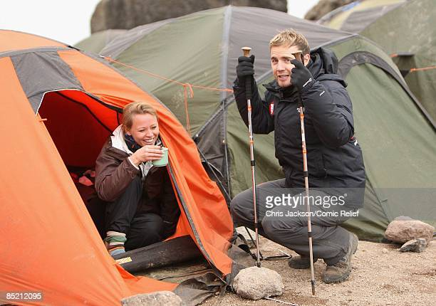 Gary Barlow and Kimberley Walsh have a cup of tea as they arrive in camp on the third day of The BT Red Nose Climb of Kilimanjaro on March 4 2009 in...