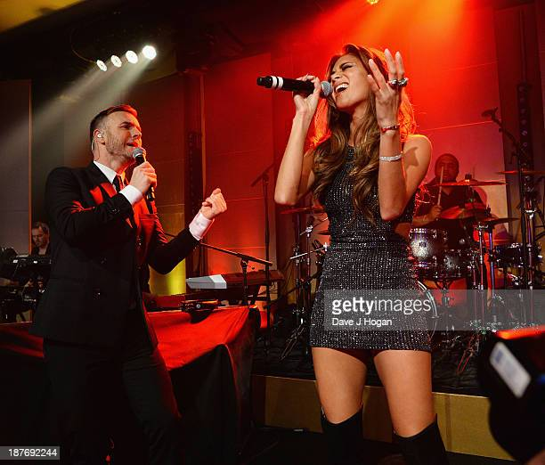 Gary Barlow and Nicole Scherzinger perform as Gary Barlow hosts BBC Children In Need Gala at The Grosvenor House Hotel on November 11 2013 in London...