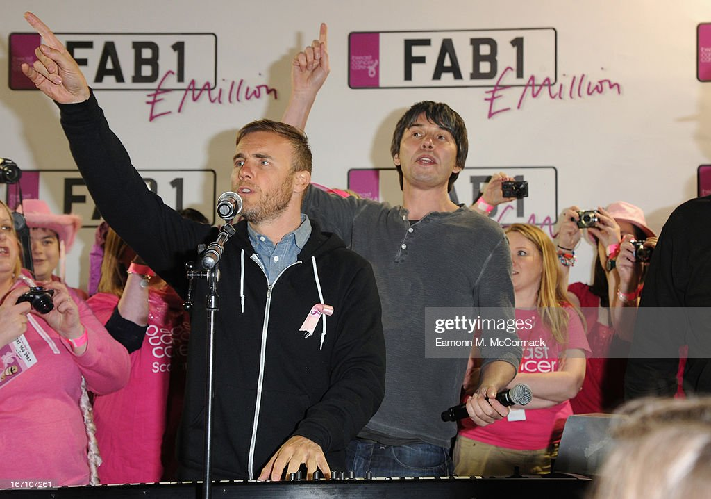 <a gi-track='captionPersonalityLinkClicked' href=/galleries/search?phrase=Gary+Barlow&family=editorial&specificpeople=616384 ng-click='$event.stopPropagation()'>Gary Barlow</a> and Professor Brian Cox during the FAB1 Million drive from Land's End to John O'Groats on April 18, 2013 in UNSPECIFIED, United Kingdom. FAB1 Million aims to raise one million pounds for Breast Cancer Care using a bespoke pink Rolls Royce Ghost with the original FAB1 Thunderbirds number plate, which is available for hire.