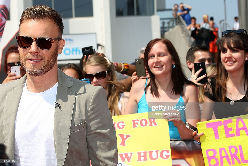 Gary Barlow arrives for the last day of the London auditions of The X Factor at Wembley Arena on July 18, 2013 in London, England.