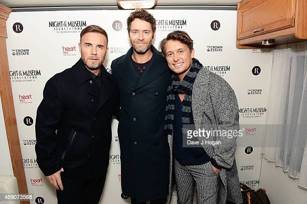 Gary Barlow Howard Donald and Mark Owen of Take That arrive to switch on the Regent Street Christmas Lights at Regent Street on November 16 2014 in...