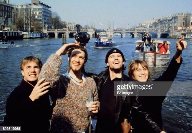 Gary Barlow Howard Donald Jason Orange and Mark Owen of the pop group Take That wave to fans from a launch outside the Amstel Hotel in AmsterdamThe...