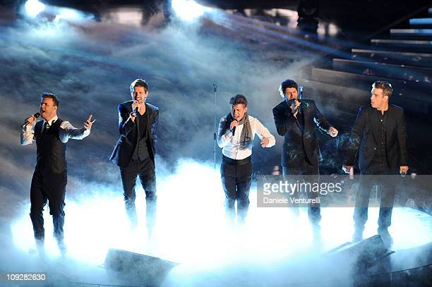 Gary Barlow Howard Donald Jason Orange Mark Owen and Robbie Williams of the British band 'Take That' perform the 61th Sanremo Song Festival at the...