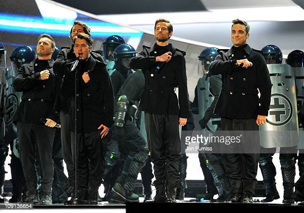 Gary Barlow Howard Donald Mark Owen Jason Orange and Robbie Williams of Take That perform on stage at the The BRIT Awards 2011 at O2 Arena on...