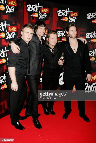 Gary Barlow Jason Orange Mark Owen and Howard Donald of Take That pose in the awards room after winning the award for best British Single at the BRIT...
