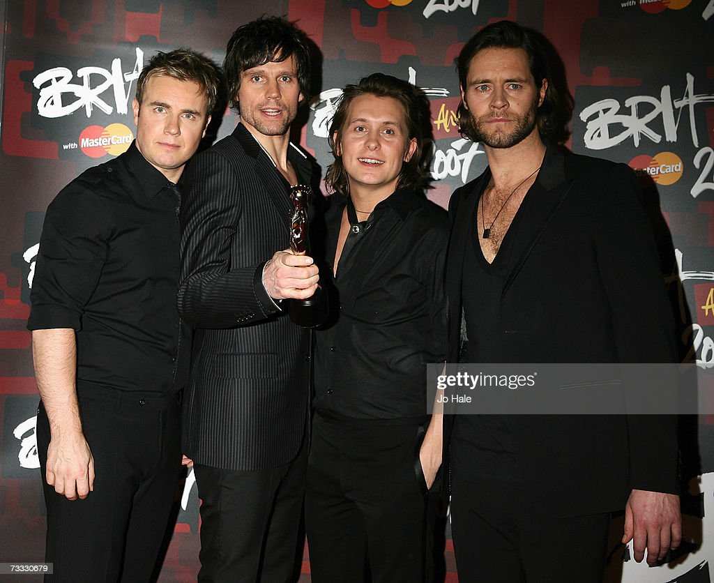 Gary Barlow, Jason Orange, Mark Owen and Howard Donald of Take That pose in the awards room after winning the award for best British Single at the BRIT Awards 2007 in association with MasterCard at Earls Court on February 14, 2007 in London,England.