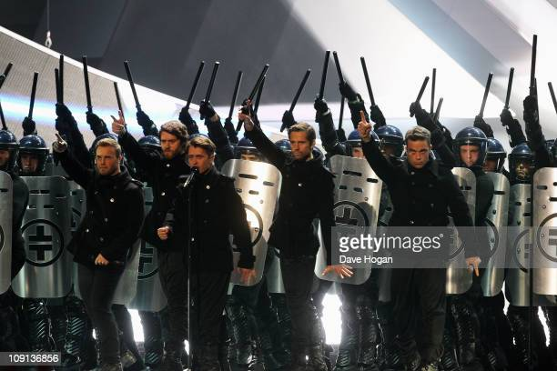 Gary Barlow Jason Orange Mark Owen Howard Donald and Robbie Williams of Take That perform onstage at The Brit Awards 2011 held at The O2 Arena on...
