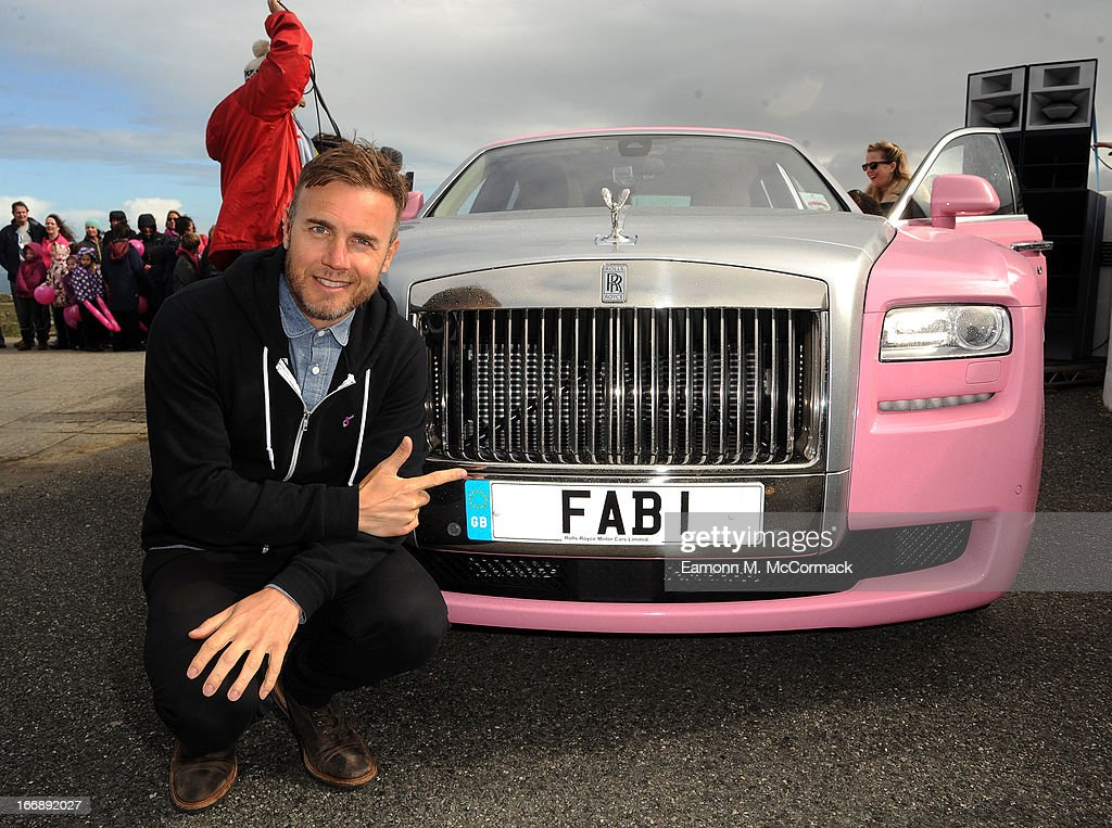 <a gi-track='captionPersonalityLinkClicked' href=/galleries/search?phrase=Gary+Barlow&family=editorial&specificpeople=616384 ng-click='$event.stopPropagation()'>Gary Barlow</a> launches FAB1 Million by driving from Land's End to John O'Groats on April 18, 2013 in Land's End, England. FAB1 Million aims to raise one million pounds for Breast Cancer Care using a bespoke pink Rolls Royce Ghost with the original FAB1 Thunderbirds number plate, which is available for hire.