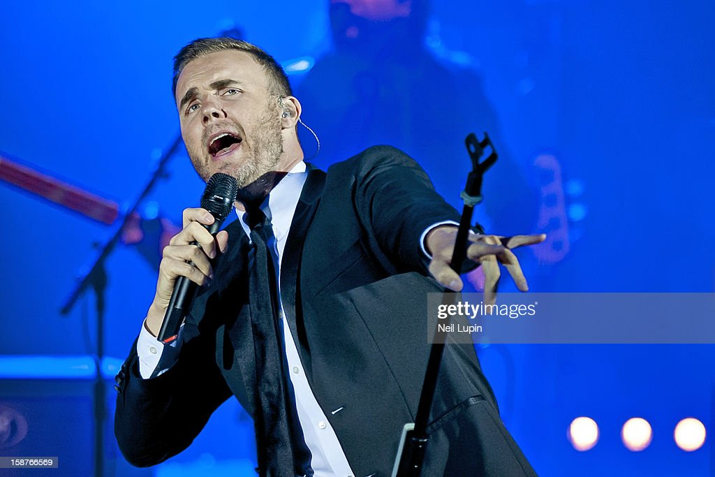 <a gi-track='captionPersonalityLinkClicked' href=/galleries/search?phrase=Gary+Barlow&family=editorial&specificpeople=616384 ng-click='$event.stopPropagation()'>Gary Barlow</a> performs at Hammersmith Apollo on December 27, 2012 in London, England.