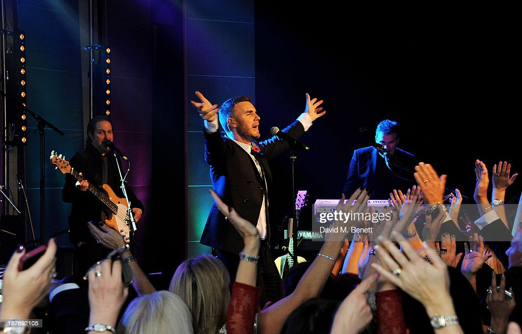 <a gi-track='captionPersonalityLinkClicked' href=/galleries/search?phrase=Gary+Barlow&family=editorial&specificpeople=616384 ng-click='$event.stopPropagation()'>Gary Barlow</a> performs at the BBC Children in Need Gala hosted by <a gi-track='captionPersonalityLinkClicked' href=/galleries/search?phrase=Gary+Barlow&family=editorial&specificpeople=616384 ng-click='$event.stopPropagation()'>Gary Barlow</a> at The Grosvenor House Hotel on November 11, 2013 in London, England.