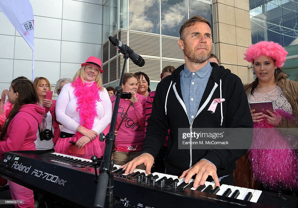 <a gi-track='captionPersonalityLinkClicked' href=/galleries/search?phrase=Gary+Barlow&family=editorial&specificpeople=616384 ng-click='$event.stopPropagation()'>Gary Barlow</a> performs outside the Birmingham NEC during the FAB1 Million by driving from Land's End to John O'Groats on April 18, 2013 in Birmingham, United Kingdom. FAB1 Million aims to raise one million pounds for Breast Cancer Care using a bespoke pink Rolls Royce Ghost with the original FAB1 Thunderbirds number plate, which is available for hire.