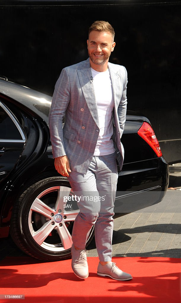 <a gi-track='captionPersonalityLinkClicked' href=/galleries/search?phrase=Gary+Barlow&family=editorial&specificpeople=616384 ng-click='$event.stopPropagation()'>Gary Barlow</a> pictured arriving at Wembley Arena for the X Factor auditions on July 15, 2013 in London, England.