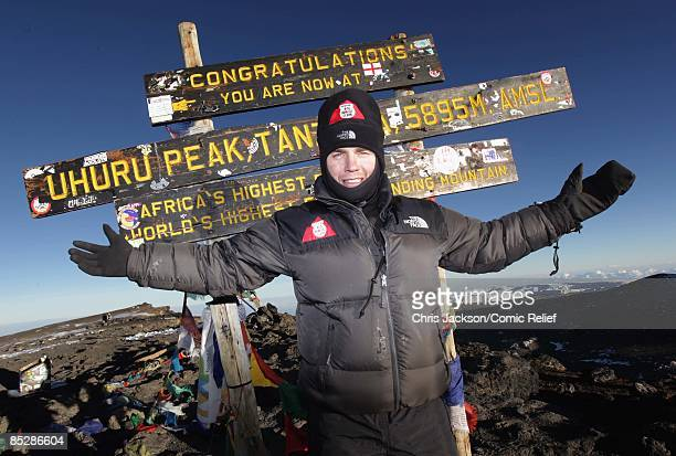 Gary Barlow reaches the top of Mount Kilimanjaro on the seventh day of The BT Red Nose Climb of Kilimanjaro on March 7 2009 in Arusha Tanzania...