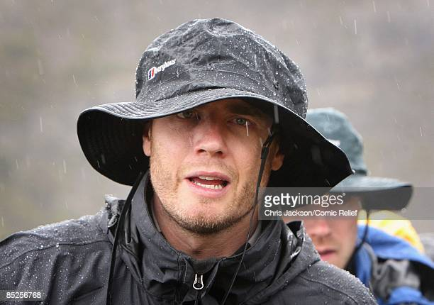 Gary Barlow treks into camp in the rain on the fifth day of The BT Red Nose Climb of Kilimanjaro on March 5 2009 near Arusha Tanzania Celebrities...
