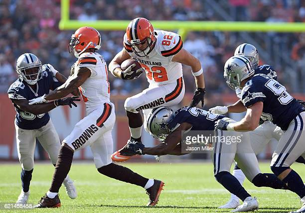 Gary Barnidge of the Cleveland Browns hurdles Darius Jackson of the Dallas Cowboys in the first half at FirstEnergy Stadium on November 6 2016 in...