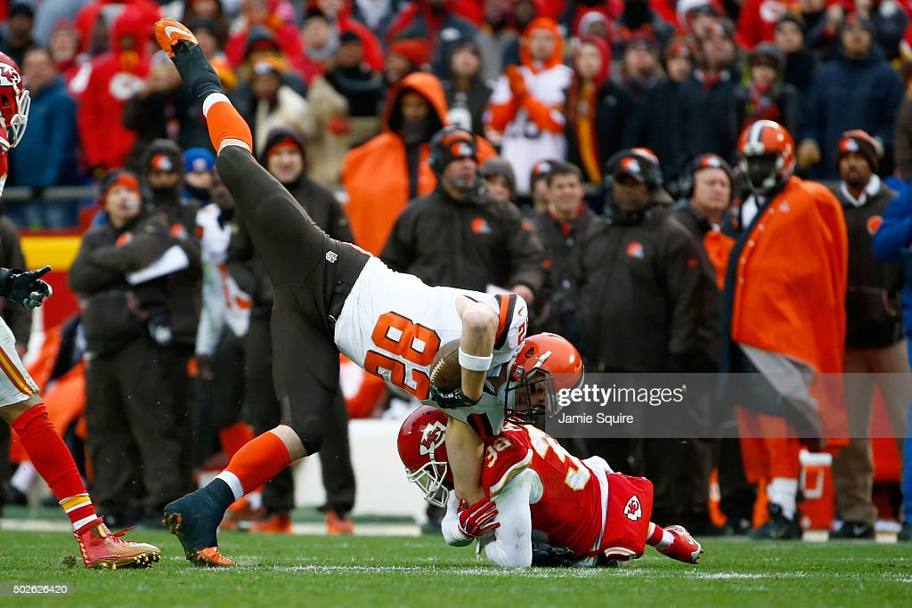 Gary Barnidge #82 of the Cleveland Browns is tackle byRon Parker #38 of the Kansas City Chiefs at Arrowhead Stadium during the fourth quarter of the game on December 27, 2015 in Kansas City, Missouri.