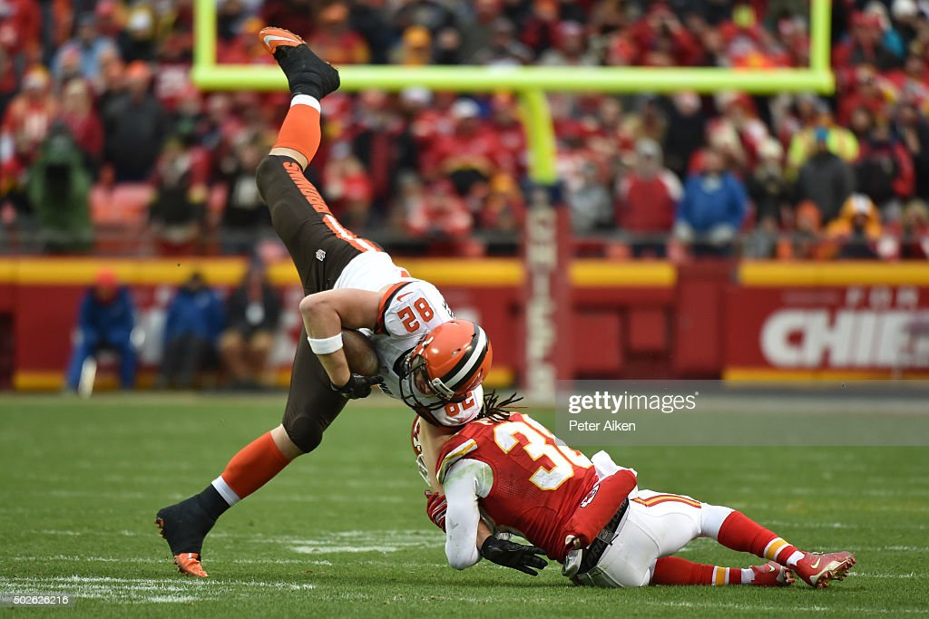 Gary Barnidge #82 of the Cleveland Browns is tackled by Ron Parker #38 of the Kansas City Chiefs at Arrowhead Stadium during the fourth quarter of the game on December 27, 2015 in Kansas City, Missouri.