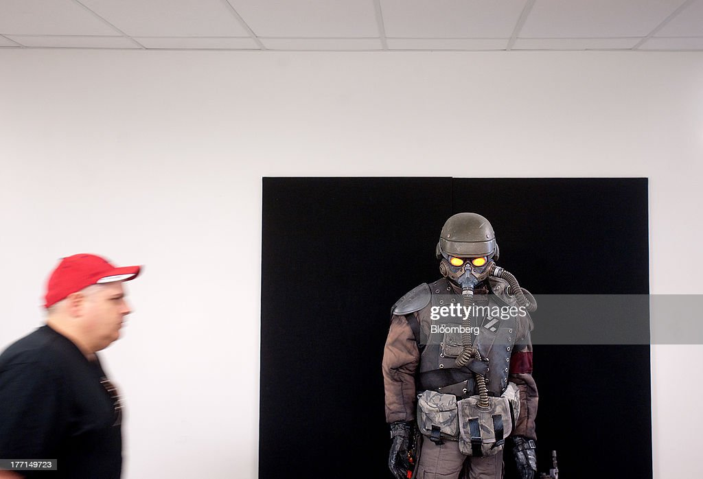 Gary Barth, senior manager of fabrication arts and design, passes a Helghast soldier from the Kill Zone video game series at Sony Computer Entertainment America's headquarters in San Mateo, California, U.S., on Tuesday, Aug. 20, 2013. Sony Corp. will start selling the PlayStation 4 in North America on Nov. 15, moving to obtain an early advantage in the largest video-game market against Microsoft Corp. Photographer: Noah Berger/Bloomberg via Getty Images *