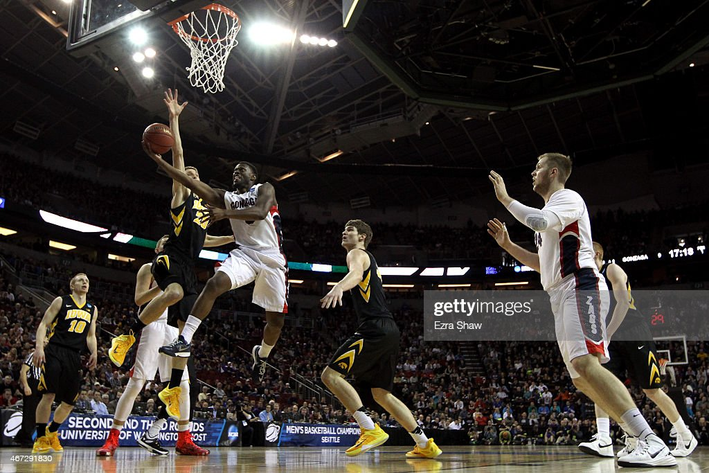 Gary Bell Jr. #5 of the Gonzaga Bulldogs shoots the ball against Jarrod Uthoff #20 of the Iowa Hawkeyes in the first half of the game during the third round of the 2015 NCAA Men's Basketball Tournament at KeyArena on March 22, 2015 in Seattle, Washington.