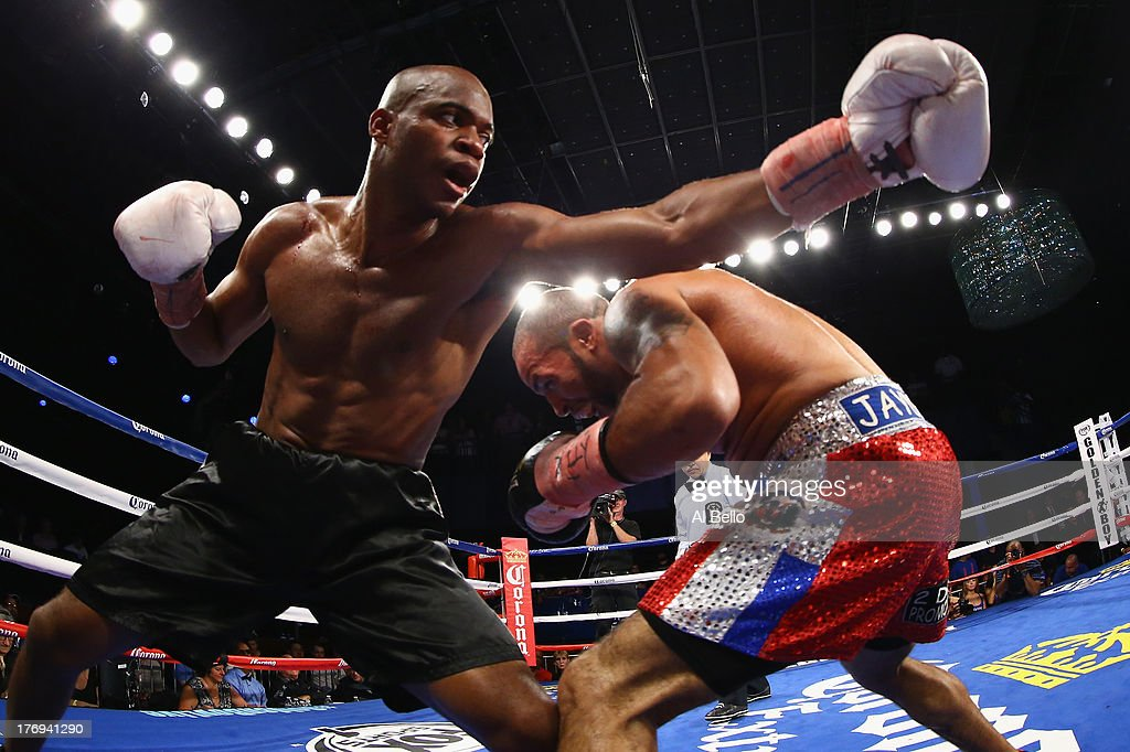 Gary Beriguette punches Kamal Muhammad during their Junior Middleweight fight at Best Buy Theater on August 19, 2013 in New York City.