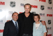 Gary Bettman and Tim Robbins and son Miles during The NHL and FHM Magazine Celebrate The 20062007 Hockey Season at Marquee in New York City New York...