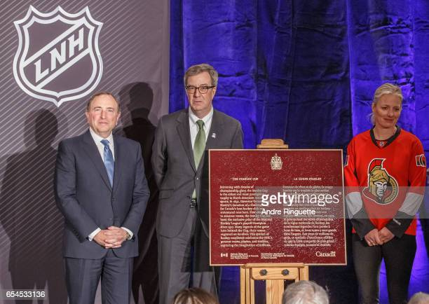 Gary Bettman Jim Watson and Catherine McKenna unveil a plaque commemorating the Stanley Cup during the 2017 Scotiabank NHL 100 Classic announcement...