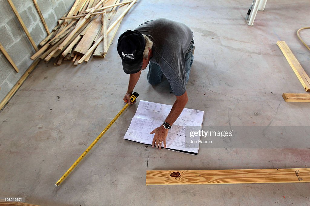 Gary Blais, site supervisor, uses a blueprint to layout the floor plan of a Habitat for Humanity home he is helping build on August 3, 2010 in Fort Lauderdale, Florida. In July, Habitat for Humanity was named the eighth largest homebuilder in the United States by Builder's Magazine, the first time the nonprofit has been among the top 10 biggest builders in the United States.