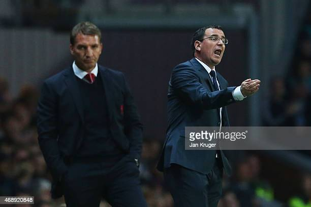 Gary Bowyer manager of Blackburn Rovers gives instructions as Brendan Rodgers manager of Liverpool looks on during the FA Cup Quarter Final Replay...