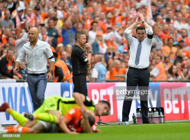 Gary Bowyer manager of Blackpool applauds as Paul Tisdale manager of Exeter City looks on during the Sky Bet League Two Playoff Final between...