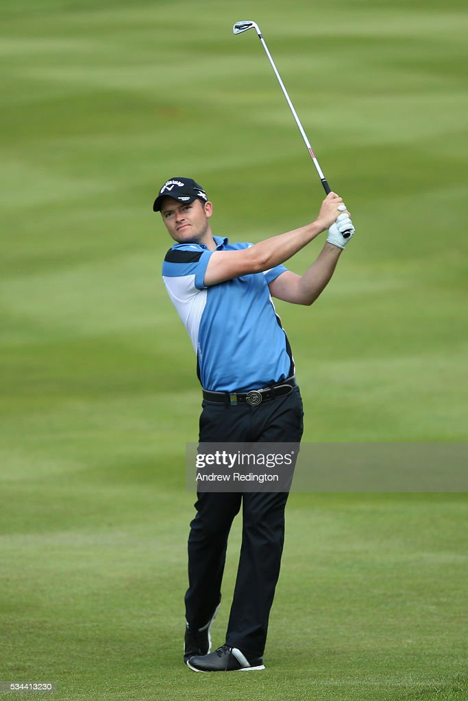 <a gi-track='captionPersonalityLinkClicked' href=/galleries/search?phrase=Gary+Boyd+-+Golfer&family=editorial&specificpeople=4686344 ng-click='$event.stopPropagation()'>Gary Boyd</a> of England hits his 2nd shot on the 4th hole during day one of the BMW PGA Championship at Wentworth on May 26, 2016 in Virginia Water, England.