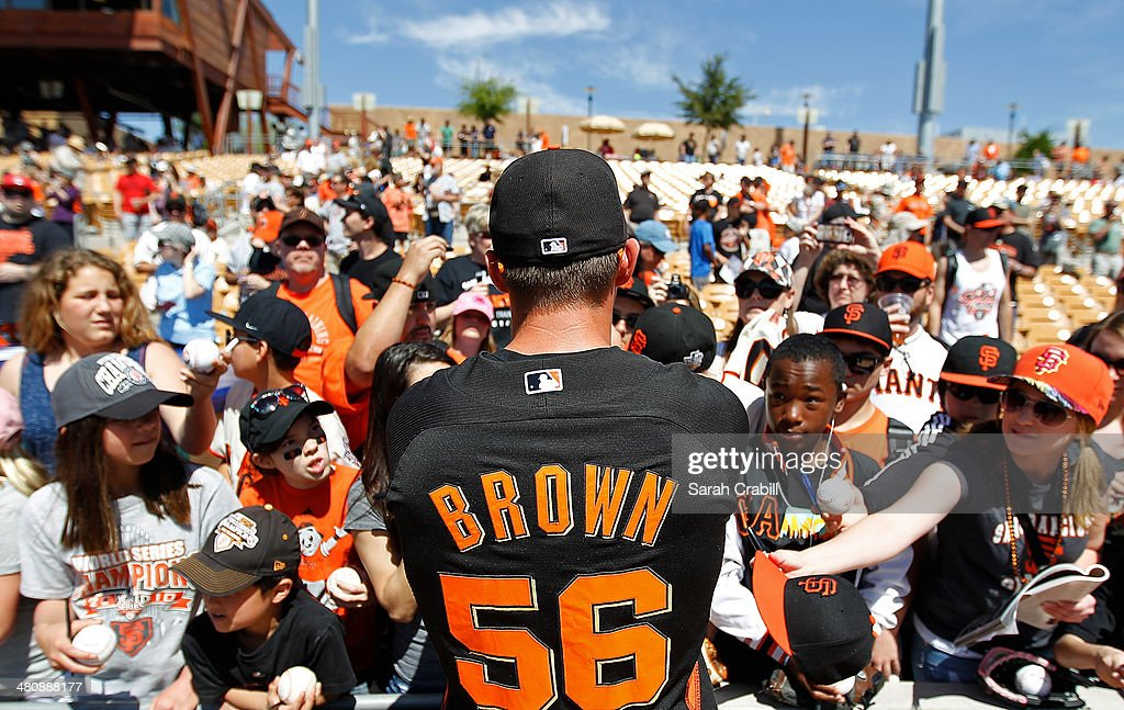 <a gi-track='captionPersonalityLinkClicked' href=/galleries/search?phrase=Gary+Brown&family=editorial&specificpeople=196518 ng-click='$event.stopPropagation()'>Gary Brown</a> #56 of the San Francisco Giants signs autographs before a spring training game against the Chicago White Sox at Camelback Ranch on March 22, 2014 in Glendale, Arizona.