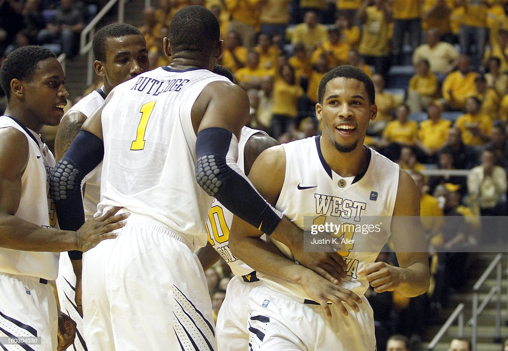 Gary Browne #14 of the West Virginia Mountaineers reacts after being fouled by the Kansas Jayhawks at the WVU Coliseum on January 28, 2013 in Morgantown, West Virginia. The Jayhawks defeated WVU
