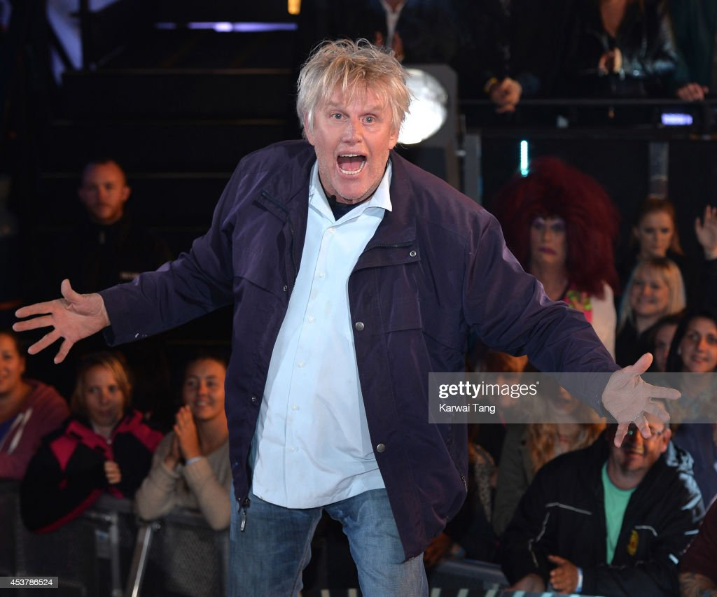<a gi-track='captionPersonalityLinkClicked' href=/galleries/search?phrase=Gary+Busey&family=editorial&specificpeople=206115 ng-click='$event.stopPropagation()'>Gary Busey</a> enters the Celebrity Big Brother house at Elstree Studios on August 18, 2014 in Borehamwood, England.
