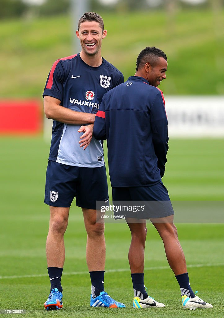 Gary Cahill and Ashley Cole of England joke around during a training session at St Georges Park on September 3, 2013 in Burton-upon-Trent, England.