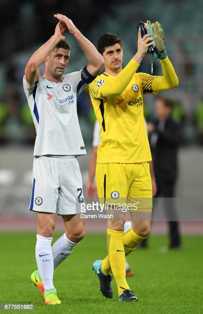 Gary Cahill and Thibaut Courtois of Chelsea celebrate victory after the UEFA Champions League group C match between Qarabag FK and Chelsea FC at Baki...