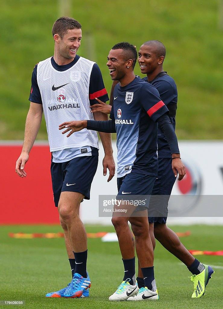 Gary Cahill, Ashley Cole and Ashley Young of England share a joke during a training session at St Georges Park on September 3, 2013 in Burton-upon-Trent, England.