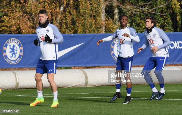Gary Cahill Charly Musonda and Marcos Alonso of Chelsea during a training session at Chelsea Training Ground on November 3 2017 in Cobham England