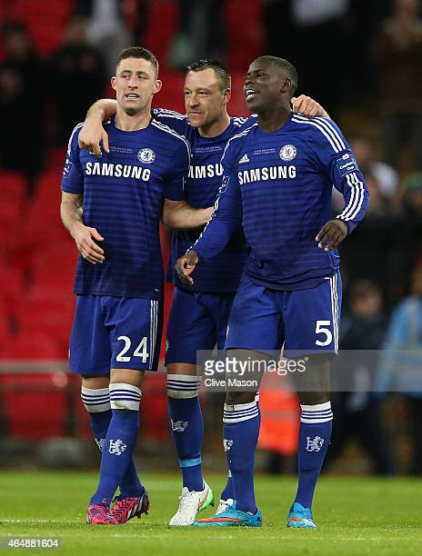 Gary Cahill John Terry and Kurt Zouma of Chelsea celebrate after victory in the Capital One Cup Final match between Chelsea and Tottenham Hotspur at...