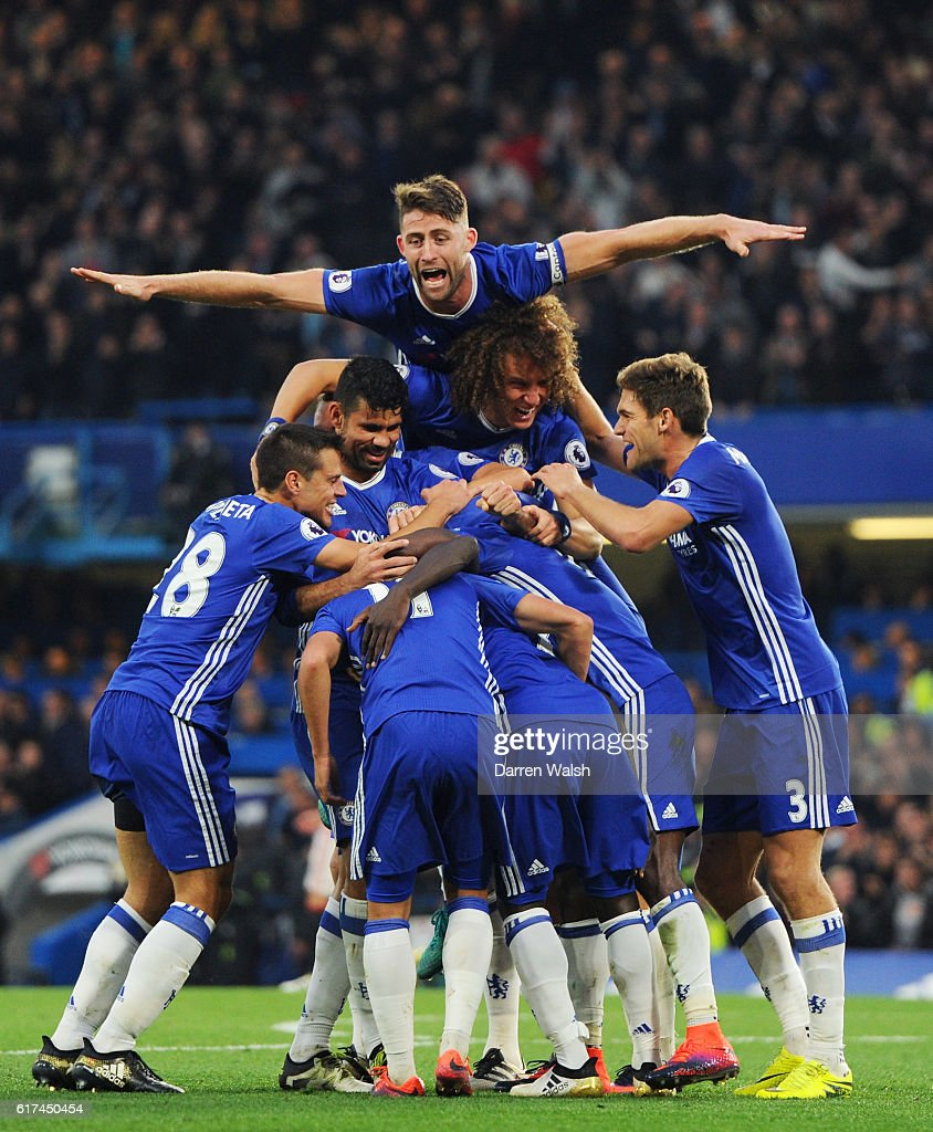 Gary Cahill joins team mates as they celebrate after N'Golo Kante scores their sides fourth goal during the Premier League match between Chelsea and Manchester United at Stamford Bridge on October 23, 2016 in London, England.
