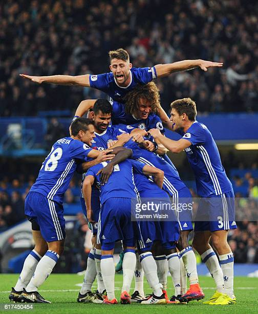 Gary Cahill joins team mates as they celebrate after N'Golo Kante scores their sides fourth goal during the Premier League match between Chelsea and...