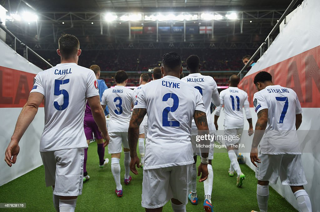 Gary Cahill Nathaniel Clyne and Raheem Sterling of England head out of the tunnel during the EURO 2016 Qualifier between England and Lithuania at...