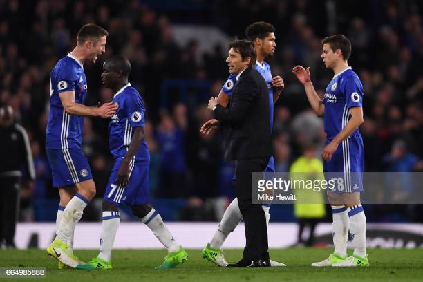 Gary Cahill of Chelsea and Antonio Conte Manager of Chelsea celebrate after the Premier League match between Chelsea and Manchester City at Stamford...