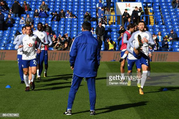 Gary Cahill of Chelsea and Cesar Azpilicueta of Chelsea warm up during the Premier League match between Chelsea and Watford at Stamford Bridge on...