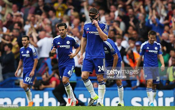 Gary Cahill of Chelsea and Cesc Fabregas of Chelsea look dejected after Bakary Sako of Crystal Palace scored the 1st goal during the Barclays Premier...