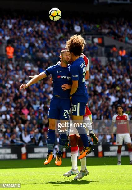 Gary Cahill of Chelsea and David Luiz of Chelsea clash heads while both attempting to head the ball during the The FA Community Shield final between...