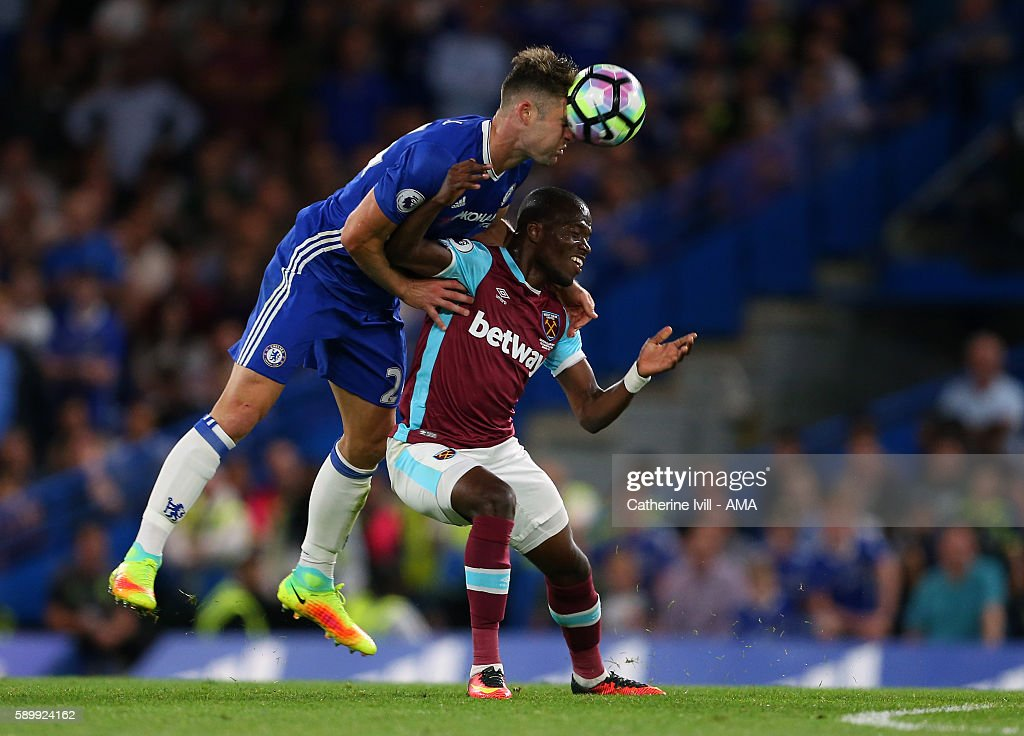 Gary Cahill of Chelsea and Enner Valencia of West Ham compete during the Premier League match between Chelsea and West Ham United at Stamford Bridge on August 15, 2016 in London, England.