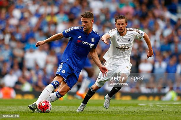 Gary Cahill of Chelsea and Gylfi Sigurdsson of Swansea City compete for the ball during the Barclays Premier League match between Chelsea and Swansea...